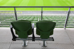 Two plastic seats on tribune of large stadium Stock Photo