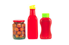 Two plastic tomato ketchup bottle and potted vegetable glass jar Royalty Free Stock Image