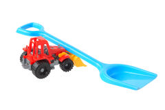 Two plastic toys. Shovel and tractor. Royalty Free Stock Image