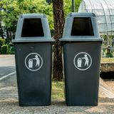 Two plastic trash can. On groud in the park Royalty Free Stock Photography