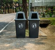 Two plastic trash can. On groud in the park Royalty Free Stock Images