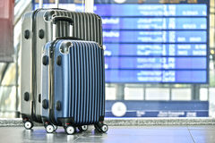 Two plastic travel suitcases in the airport hall Stock Images
