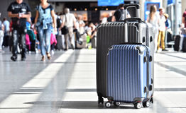 Two plastic travel suitcases in the airport hall Royalty Free Stock Photo