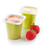 Two plastic yogurt pots Royalty Free Stock Photography