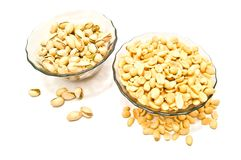 Two plate with different nuts. On white Royalty Free Stock Photos