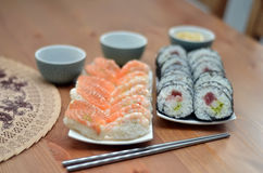 Two plate of maki sushi rolls and nigiri sushi with salmon and shrimp japan food on the table with soy sauce Stock Images