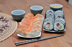 Two plate of maki sushi rolls and nigiri sushi with salmon and shrimp japan food on the table with soy sauce and ginger Stock Photos