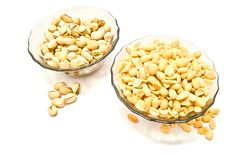 Two plate with many different nuts. Two plate with different nuts closeup on white Royalty Free Stock Photo