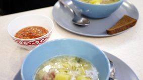 Two plates of chicken soup. Video of chicken noodle soup in small bowl moves stock video footage