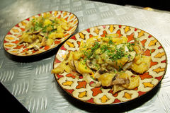 Two plates with fried potatoes. With herbs and mushrooms Stock Photography