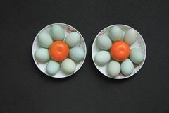 Duck eggs. Food. Ingredients. Two plates of green duck eggs. zhaofuxin 2017.8 royalty free stock photography