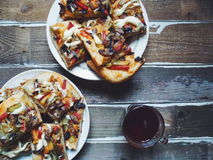 Two plates with homemade pizza and cup of tea on the table Royalty Free Stock Images