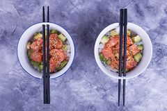Two plates with poke. Dish from rice, fish, avocado. Beautiful hawaiian dish Stock Photo