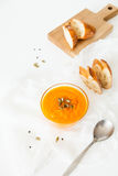 Two plates of pumpkin soup with seeds on a white background with space for your text. Royalty Free Stock Photography