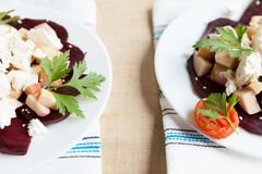 Two plates of salad with beets and goat cheese Royalty Free Stock Photography