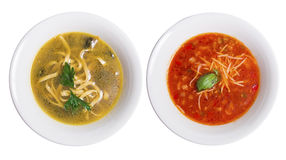 Two plates of soup. Chicken noodle soup and tomato soup with parmesan Stock Image