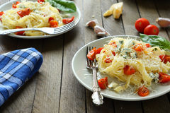 Two plates of spaghetti with tomatoes Royalty Free Stock Images