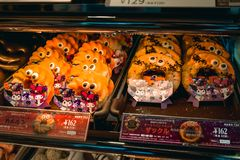 Two plates of special cute Japanese Halloween pumpkin doughnuts with eyes stock photos