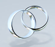 Two platinum wedding rings Royalty Free Stock Image
