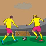 Two players attack the goal on the field stock photo
