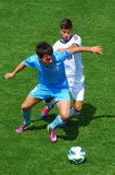 Two players fight on the field Stock Image