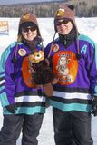 Two players from the Lady Beaverjacks pose in Rangeley, Maine. stock photos