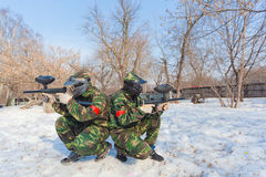 Two players of paintball in full gear sitting stock images
