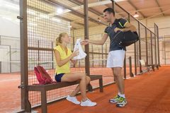 Two players relaxing after paddle tennis match Royalty Free Stock Photography