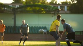 BOBRUISK, BELARUS - AUGUST 9, 2017: Two players try to catch up with the ball during soccer championship among amateur. Two players try to catch up with the ball stock video footage