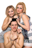 Two playful blonde and a guy in chains Royalty Free Stock Photography