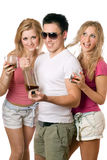 Two playful blonde woman and young man Royalty Free Stock Images