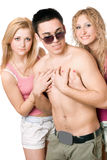 Two playful blonde women with young man Royalty Free Stock Images