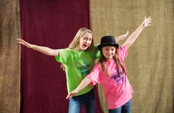 Playful friends pose for camera. Two playful friends pose for at acting camp pose with arms spread wide Royalty Free Stock Photo