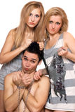 Two playful girls and a guy in chains Stock Images