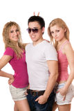 Two playful pretty women and handsome young man Royalty Free Stock Photography
