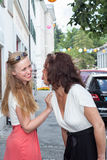 Two Playful Women Acting Childish on City Sidewalk Stock Photography