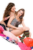Two playful young girlfriends. Isolated Royalty Free Stock Photos