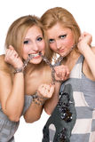 Two playful young women bound a chain Stock Image
