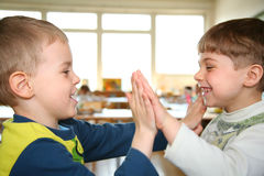 Two playing boys stock images
