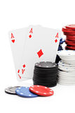Two playing cards with gambling chips Royalty Free Stock Images