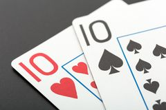 Two playing cards on grey Stock Photography