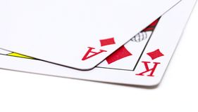Two playing cards on white background. Poker hand with diamond ace and king. Winning poker hand out. Red cards on table. Poker winner with flush royal Royalty Free Stock Image