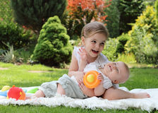 Two playing little sisters Stock Photos