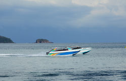 Two pleasure boats racing one another in tropical bay. Two colorful pleasure boats racing one another in tropical bay Stock Photos