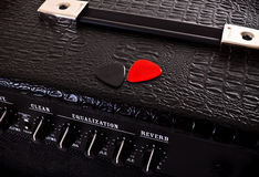 Two plectrums on guitar amplifier Royalty Free Stock Photo