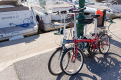 Two pliable bicyles. Attached on a maritim port royalty free stock photo
