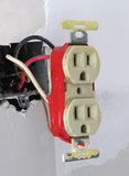 Two plug electrical outlet. Old two plug 110 volt electrical outlet, sticking out from a hole in drywall stock photo