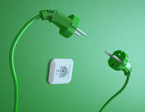 Two plugs struggle for the socket Royalty Free Stock Images