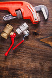 Two plumbers fixtures and monkey wrench on vintage Royalty Free Stock Images