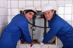 Two plumbers resting after work Stock Images